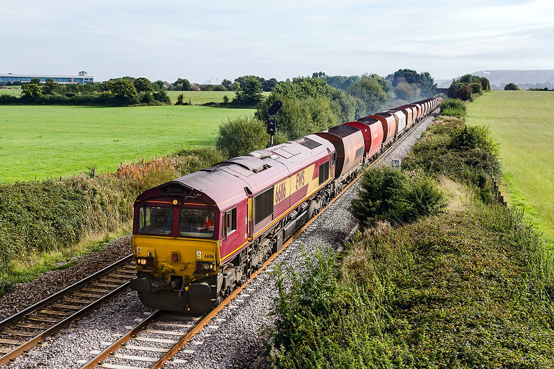 28th Sep 2016:  Having started from Wembley Freight Opperations Centre I though that perhaps it was a rake of the new grey stone boxes,  but no, it was the old rust buckets.  6B33 is going to Whatley and is captured as it leaves Westbury