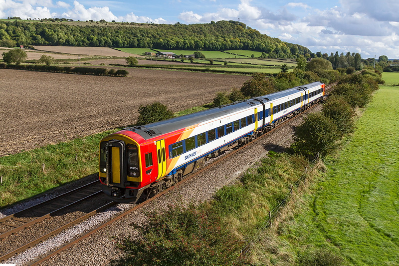 30th Sep 2016:  With Arn Hill in the background 1V33 the 13.52 from Waterloo to Bristol Temple Meads in the hands of 159104 is pictured from the Granada bridge on the Warminster By-pass