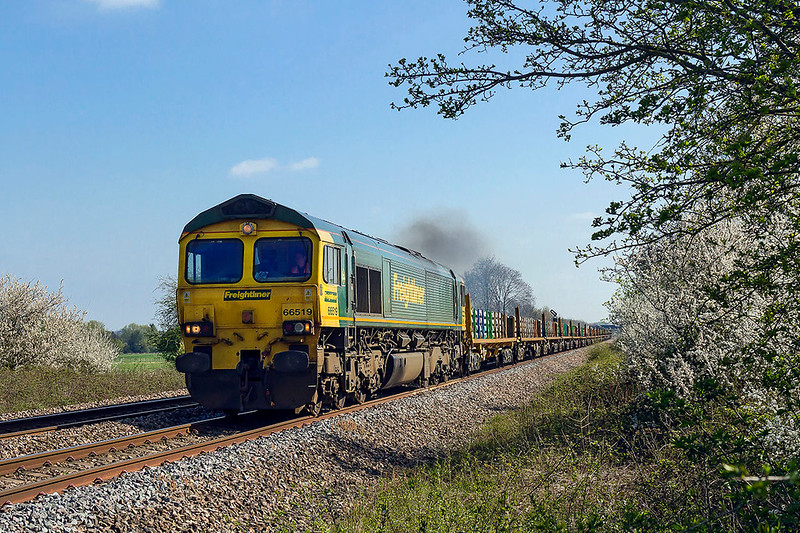 7th Apr 2017:  6C73  is usually used for a refill of the HOBC that is based in Taunton. Today it was differnt as the load is new sleepers.  With 66519 providing the urge it is pictured from Masters Xing in Fairwood