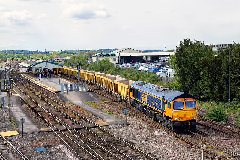 27th Apr 2017:  Under floater 66771 leaves Westbury with 6M40 to Stud Farm.  It is uncommon for this service to have a loco change during the week and for the last three days it has been 66752.  All last week as well.