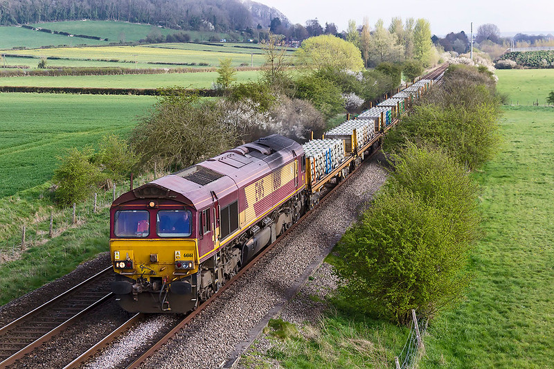 6th Apr 2017:  66161 coming back to Westbury from Eastleigh with a load of new sleepers ia about to pass under the Warminster Bypass