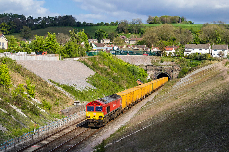 23rd Apr 2017:   Sometimes luck is on your side.  Running rather late this diverted  'Smelly Bins'  from Brentford to the Sita plant at Avonmouth  pwered by 66097 emerges from the tunnel at Chipping Sodbury.  A few secconds earlier and the whole scene was in shaddow but the cloud mirraculously cleeared as the the train emegerd from the black hole
