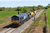 18th Apr 2017:  A very pleasant surpprise today was to find the ex DRS liveried 66413 entrusted  with the Fairwater Yard to Westbury and return working.  6C73 now with the two waggons refilled with ballast  are pictured at Fairwood next the the now totally cleared trackside.