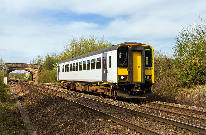 5th Apr 2017:  From the foot crossing in Heywood 153305 is captured as it works 2M13 the 15.12 from Swindon to Westbury.  The unbranded white finnish I suspect has been applied because the  unit will shoirtly come 'Off Lease'.  Good bye !!