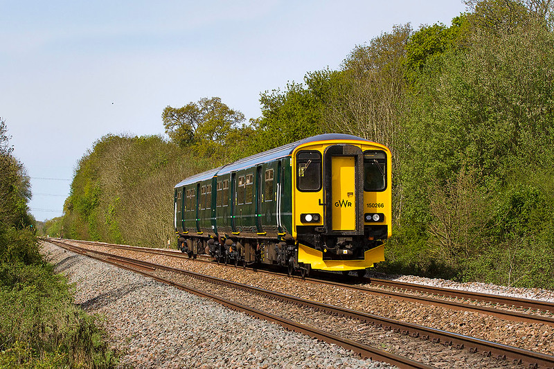 27th Apr 2017:  Unfortunately there is not much that can be done  to enhance the grotty green that is now used  by GWR.  150266, now in Holly Green, is working as 2V88 the 08.53 from Weymouth to Bristol Temple Meads.  The location is Masters Crossing just to the west of Fairwood  Junction.