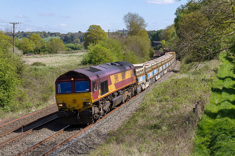 22nd Apr 2017:  66011 is working 6W10 from Hinksey to Bristol East Junction via Reading and Taunton.  This roundabout route is caused by the closure of Bath Spa  for platform alrterations to be made.  The location is Great Chevrell, Lavington Station was just out of sught raound the corner