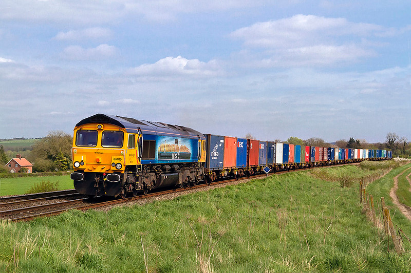11th Apr 2017:  6M46 the new  MOD service from Marchwood to Bicester is in the hands of GBRf.  It is routed via the Wylye Valley and today is in the hands of 66709 'Sorento' and  is pictured at Bapton