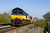 9th Apr 2017:  66850 top and tail with 66847 grind up the hill through Dilton Marsh with a rake of Auto Ballasters.  6C02 is running from Gillingham to Eastleigh