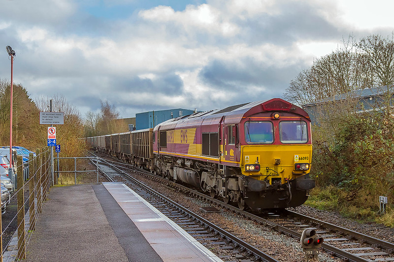 13th Dec 2017:   Trotting though Warminser is the 11.47 from Fareham to Whatley quarry.  Powered by 66093 7V16 was running 6 minutes late at this point but after reversal at Westbury it was 8 minuts early when it arrived at the quarry.