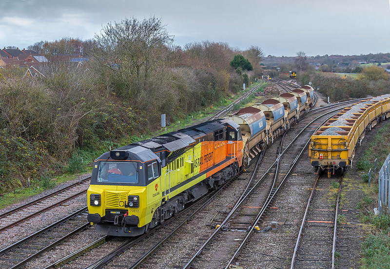 3rd Dec 2017:  6 minutes after 70810 passed with 6C21  from Filton Abbey Wood 70812  arrives at Westbury powering 6C20 from Cheltenham Spa hauling a set of Auto ballasters