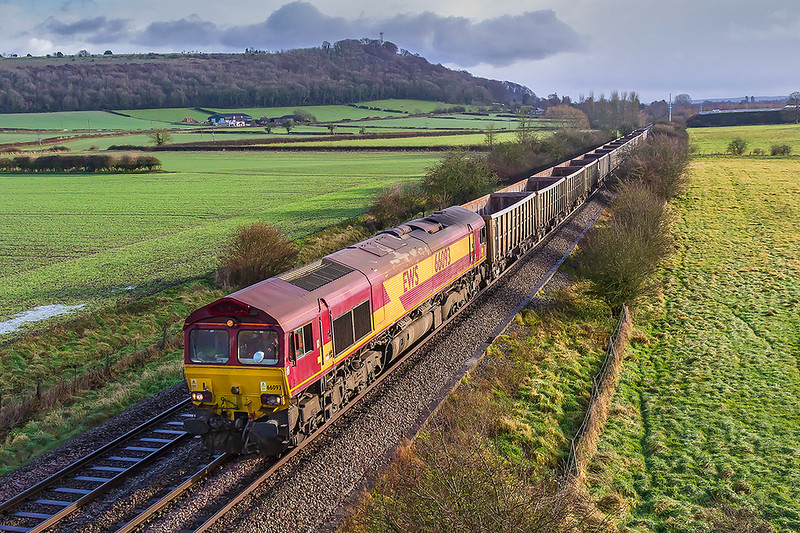14th Dec 2017:  For the second time this week 66093 is tasked with 7V16 from Fareham to Whatley quarry.  Fortunately there was a glimpse of sun at just the right time.  I went to Granada Bridge on the Warminster By Pass to picture the Colas 67s on the 1Q29 test train on the Salisbury to Westbury leg of the day's itinery but it was running late and it starting to rain again.  I went home rather than wait