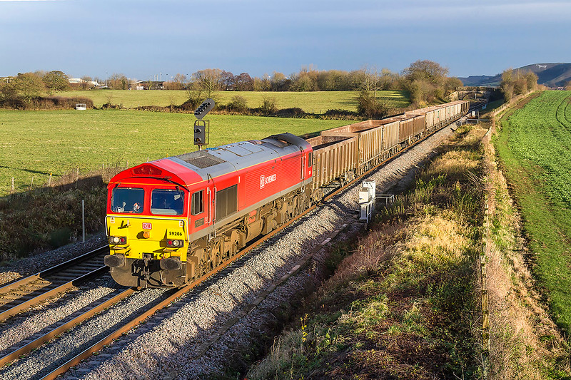 11th Dec 2017:  59206 is running 17 minutes early as it runs between Westbury and Fairwood Junction with 7V16 from Fareham to Whatley Quarry