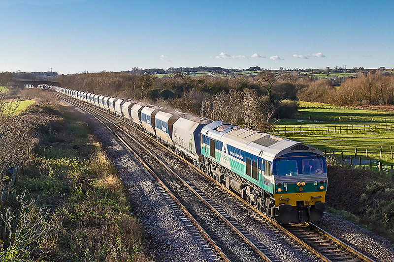 11th Dec 2017:   The Whatley Quarry to Dagenhan Dock ARC is pictured as it leaves Fairwood Junction.  Powered by 59005 6L21 has a load of 45 wagons, approximately 4500 tons.  Trains  with a load of over 4000 tons are common starting from  the Whatley and Merehead Quarries