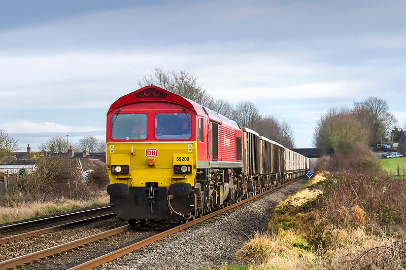19th Dec 2017:  59203 running through Wylye with 7V16 the empty boxes from Fareham at 11.47 to Whatley quarry