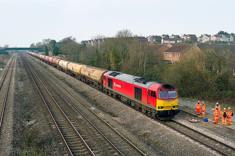 13th Feb 2017:  The 05.00 from Robeston to Westerleigh, 6B13, is in the hands of 60074 which is now in Schenker red.  I always though that it always looked better in the Save the Children blue livery.  The location is Undy in South Wales