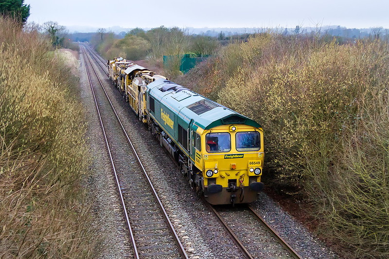 20th Feb 2017:  66549 trots along the Westbury New Line  AKA 'Cut Off'  or these days 'Avoider' with 6Y19.  This left Fairwater Yard in Taunton at 09.20 to to take the middle bits of the MOBC  DR76323  92282 to Willesden Euroterminal