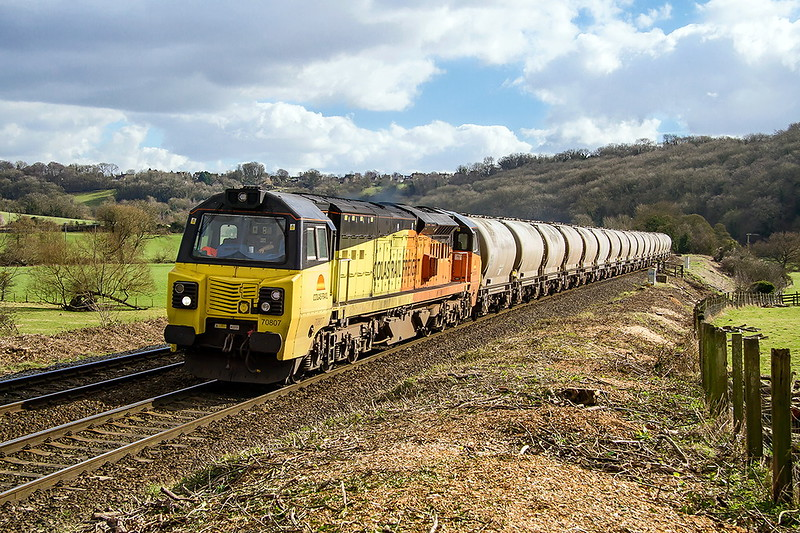 24th Feb 2017:  Once again 70807 is tasked with hauling 6C36 empty PCAs from Westbury  Cement Works to Aberthaw Cenent Works.  The location is of course Freshford