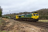 19th Feb 2017:  66593 is working 6Y97  the 07:35 from Miskin to Eastleigh Yard via Salisbury.  Pictured here leaving Freshford