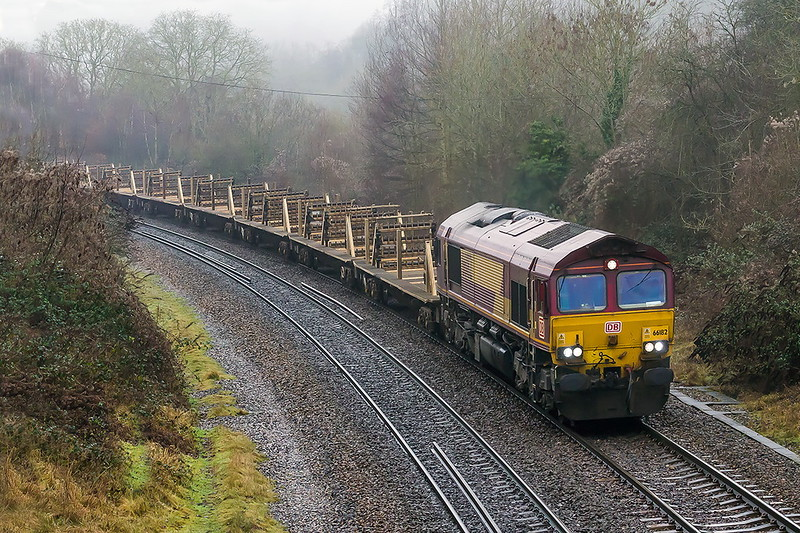 8th Jan 2017:  6W97 is the 09.30 from Moreton on Lugg to Westbury with a rake of empty rail carriers.  I truly foul conditions 66182 is aptured as runs through Freshford