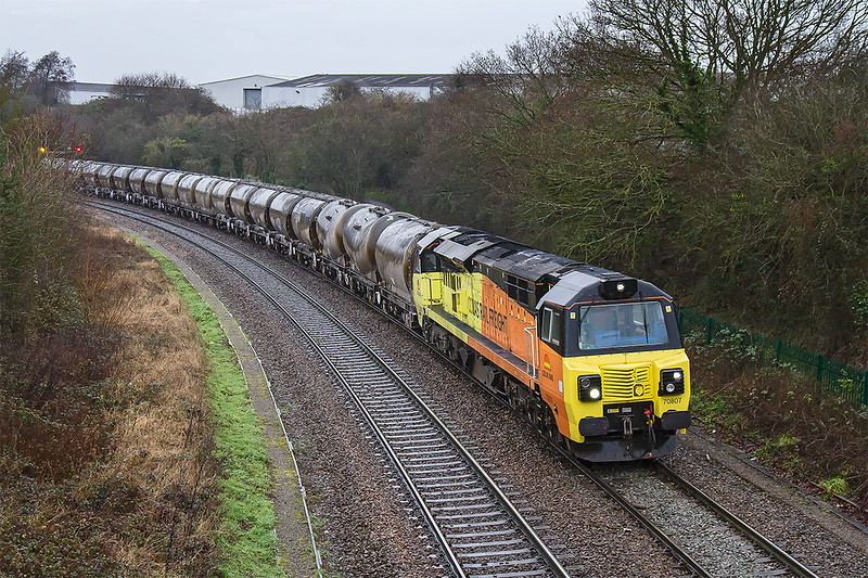 6th Jan 2017:  All 19 PCA loaded cement tanks are in view as 70807 rounds the curve away fron Bradford Junctionj on the outskirts of Trowbridge.It was raining as 6Z70 from Barry heads for the remaining storage tanks at the Lafarge cement works at Westbury