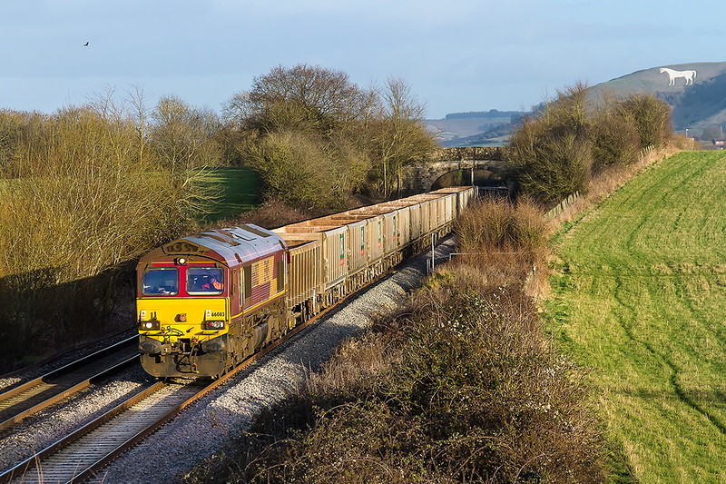 11th Jan 2017:  In superb afternoon light 66083 heads away from Westbury with 7V16 from Fareham to Whatley Quarry