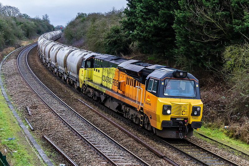 31st Jan 2017:  My first picture of January 2017 was of the last Colas 70  number 810 in crap light requiring iso 3200 so is fitting that the last shot of the month is again iso 3200 and the loco is the first of the class 70801.  Pictured at Ladydown in Trowbrisge 6C36  s ireturning the emptuy PCAs to Aberthaw Cement Works from the stoirage Silos at the old Westbury Cement Works