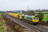 12th Jan 2017:  6 of the new HOBC wagons that were delivered to Fairwater Yard yesterday are now on their way back to Taunton having visited Westbury for a fill of ballast.  66595 and 6C73 are  pictured from as very wet Pot Lane in Berkley