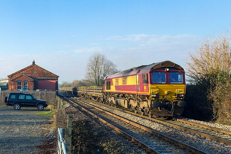 22nd Jan 2017:  Passing the old Goods Shed at Edington & Bratton station is 66107 working 6W01 from Hawkeridge Junction to Hinksey.  Track renewall south of Trowbrisge  being the starting point