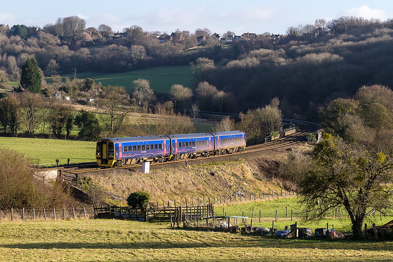 2nd Jan 2017:  Nearing Freshford is 158958 working 1F16 the 11.27 Portsmouth Harbour to Newport.  This service usually runs to Cardiff but  engineering work has forced the last leg to be a bus.