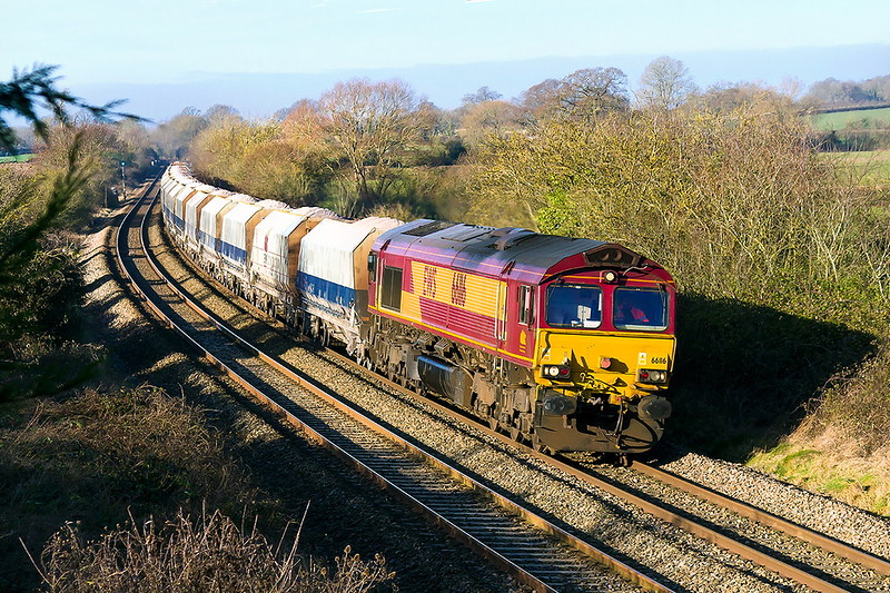 18th Jan 2017:  I was not expecting a morning of bright sunshime and other commitments meant that I was only able to get one shot. At this time of the year 6A26 to Hayes from Whatley has sun on the nose as it passes through Gret Cheverell.  66116 was on the point today