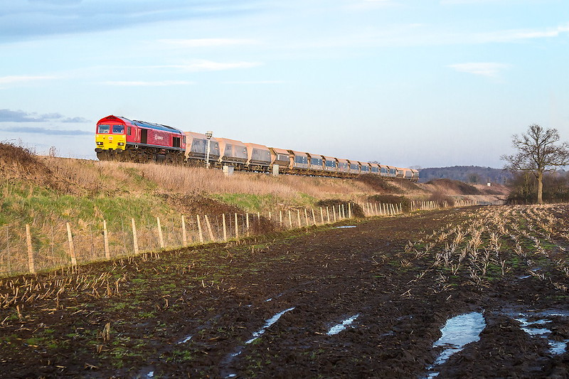 24th Jasn 2017: The water in the ruts  is still frozenn as 59203, running 69 minutes late so the sun had nearly died,  brings 7C77 from Acton to Merehead  round the curve at Coulston near Lavington