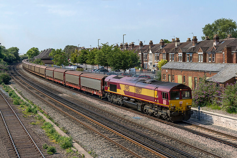6th Jul 2017:  Rounding the curve into Eastleigh is 66137 taking 6M48 from Southampton Eastern Docks to Halewood.  It is unusual fre a loco to have both  DB and EWS branding so I suspect that there has been a bonnet swap at some stage.