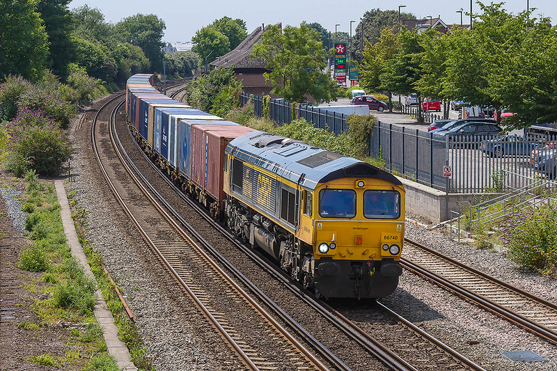 6th Jul-2017:  66740 'Sarah' is in charge of 6M46 from Marchwood to the MOD base at Biscester is pictured from the Campbell Road bridge in Eastleigh