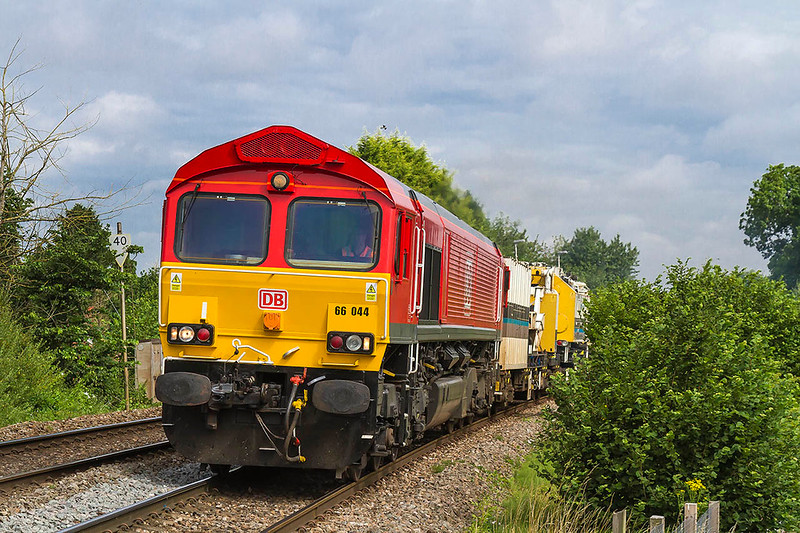 19th Jul 2017:  With a big crane in tow 66044 climbs through  Dilton Marsh with the morning departmental from Westbury to Eastleigh