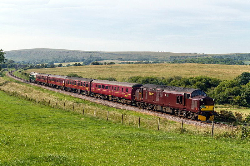 20th Jun 2017:  On the last trip of the day 37205 is pictured between Corfe Castle and Harmans Cross with the 17.19 from Wareham