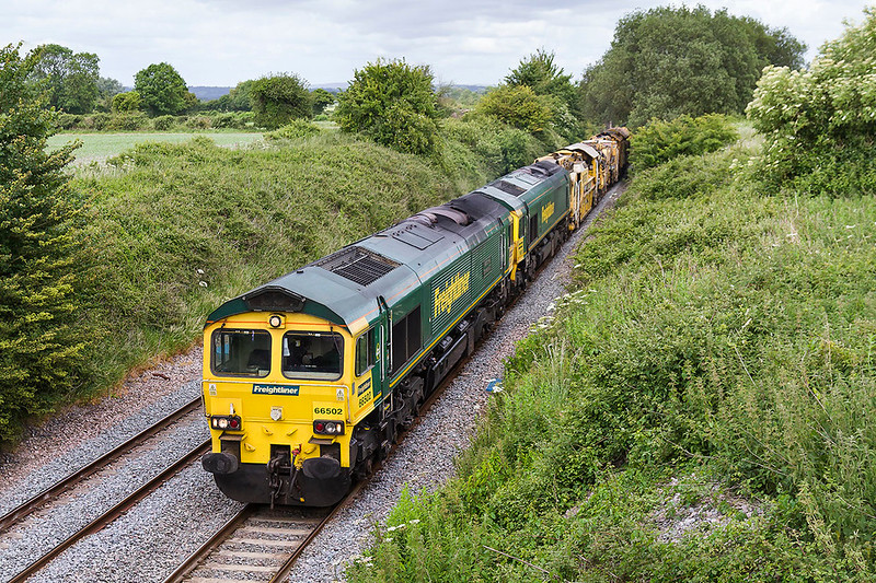 9th Jun 2017:  6Z19 was the working to get the important bits of the HOBC back to Fairwater Yard  from the Plasser works at West Ealing.. 66502 is doing all the work with 66512 tucked inside. 66520 was acting as the rearguard as the passed through Edington