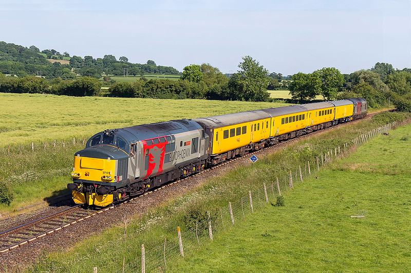 14th Jun 2017:  Now on the final leg of the day's work of 1Z22 from Weymouth to Bristol High Level Siding 37611 Pegasus runs through Thornford near Yeovil
