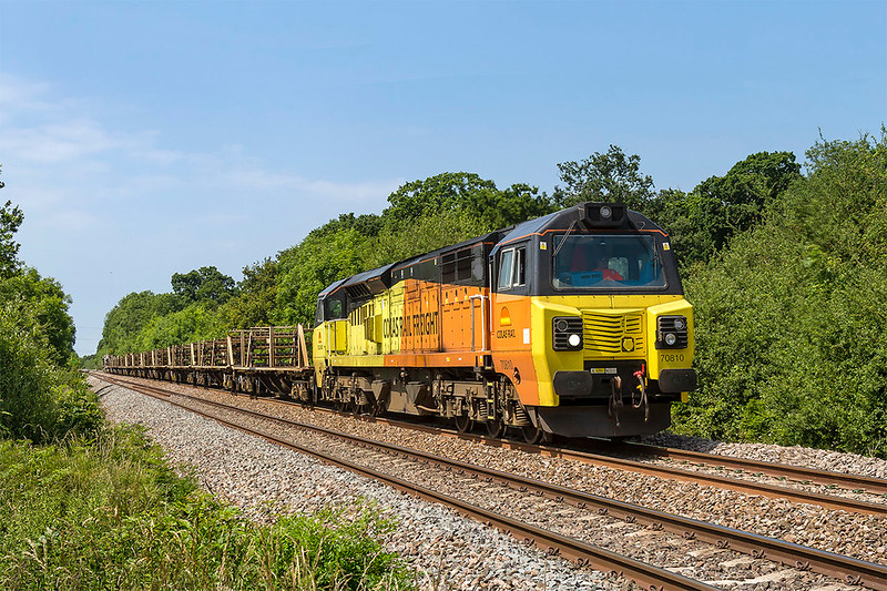 18th Jun 2017:  70810 is nearly home as it brings 6C97 back to Westbury from Saltash.  Pictured from Masters Crossing in Fairwood