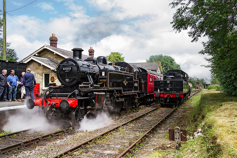 24th Jun 2017:  On it's first day in traffic since it was withdrawal by British Rail over 50 years ago Ivat LMS tank 41313  sits in  Cranmore Station as the tender version of the locomotive 46447  drifts past