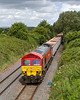 9th Jun 2017:  In an unexpected flash of sunlight 59204 runs through Edington with 7C77 from Acton to Merehead.  The location is Lambourn Lane
