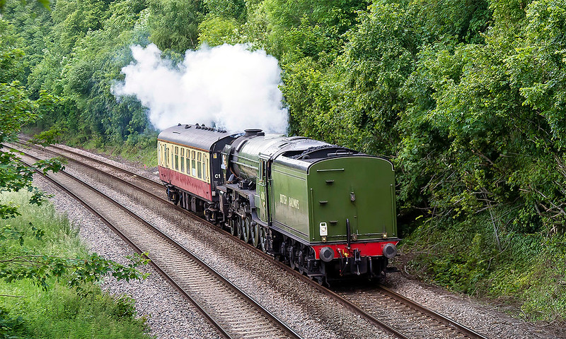 10th Jun 2017:  On it's way to Stewarts Lane after a holiday break  on the Bodmin & Wenford Line 60163 'Tornado' is captured at Norton Bavant.  As it was posted as running tender forst at Saltash I had expected ot to be the right way round after a reversal at Westbury.  That is a long way to go backwards, not much fun for the crew I expect