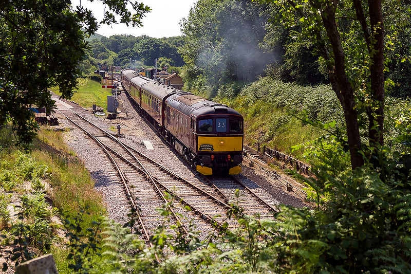 20th Jun 2017:  33025 is departing from Nordern, the northern terminus of the Swanage Railway, with 2Z18 the 10.23 from Swanage to Wareham.  37215 is on the rear.  This the first of the 4 daily return trips on the second week of operation