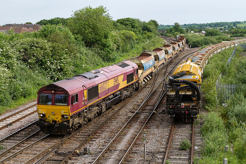 2ndJun 2017:  Arriving at Westbury is 66027 leading od 6W36 from Kidwelly to Westbury.  The 2 sets of Autoballasters  have 66031 on the rear.  It is unsual to find a Noo Noo  parked up in this siding and was rather  inconvenient fotting wise.
