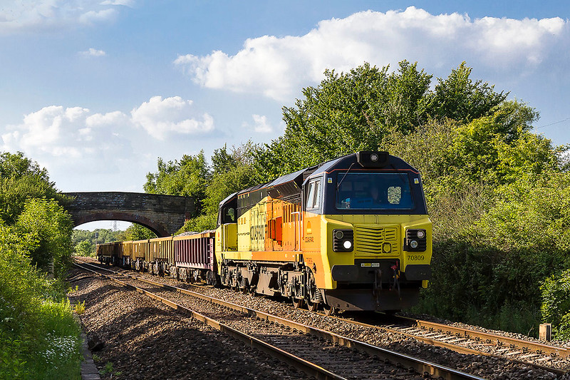18th Jun 2017:  Catching the evening light is 70809 as it works 6C26 from Lockwith North Junctionn in Cardiff to Westbury through Heywood