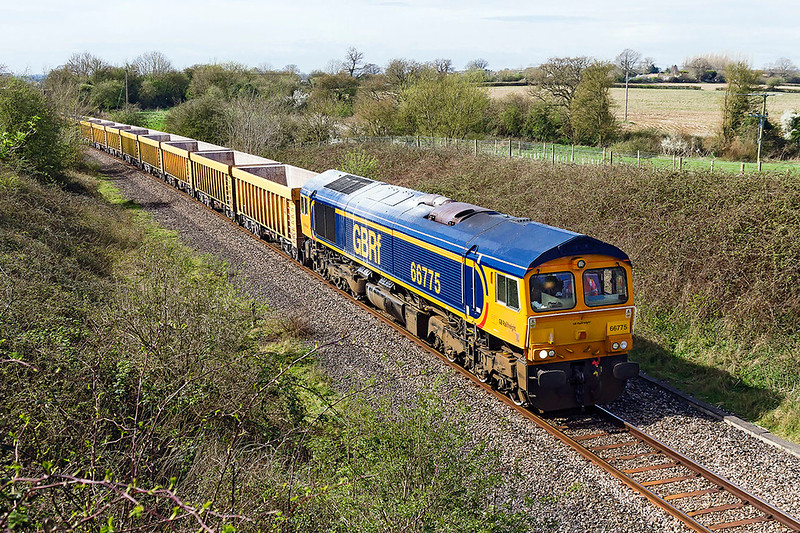 30th Mar 2017:  Running through Broughton Gifford is 66775 with 6M40 from Westbury to Stud Farm in Leicestershirefor a ballast refill