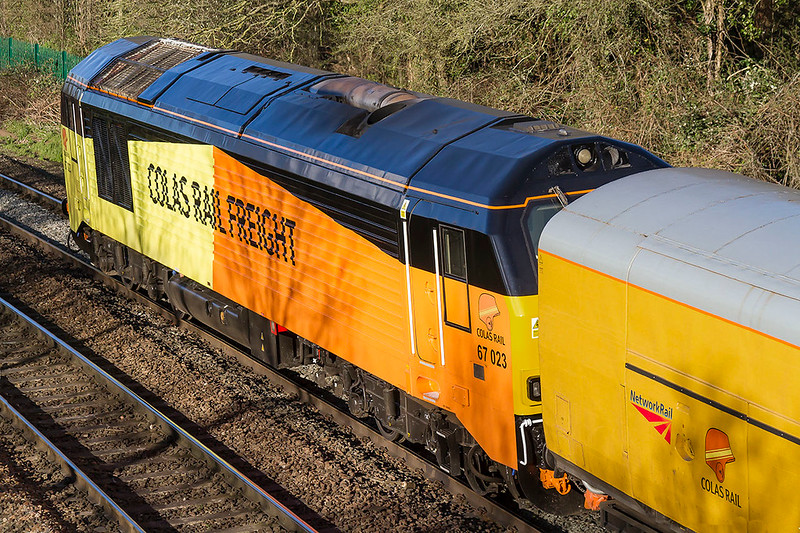 22nd Mar 2017:  67023 now owned by Colas and rebranded is on the rear of 1Z79 workijing from Tyseley to Bristol through Ladydown in Trowbridge.   Note that the NetworkRail stock also carries Colas branding