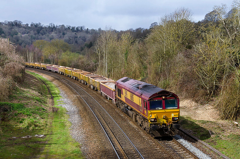 19t5h Mar 2017:  Rounding the curve into Freshford is 66015 powering 6W04 the 10.10 from Aberthaw to Westbury Up Yard.  Theday's only sun shine miraculously  appeared as the train came into view  and had gone before the  last wagon passed through.