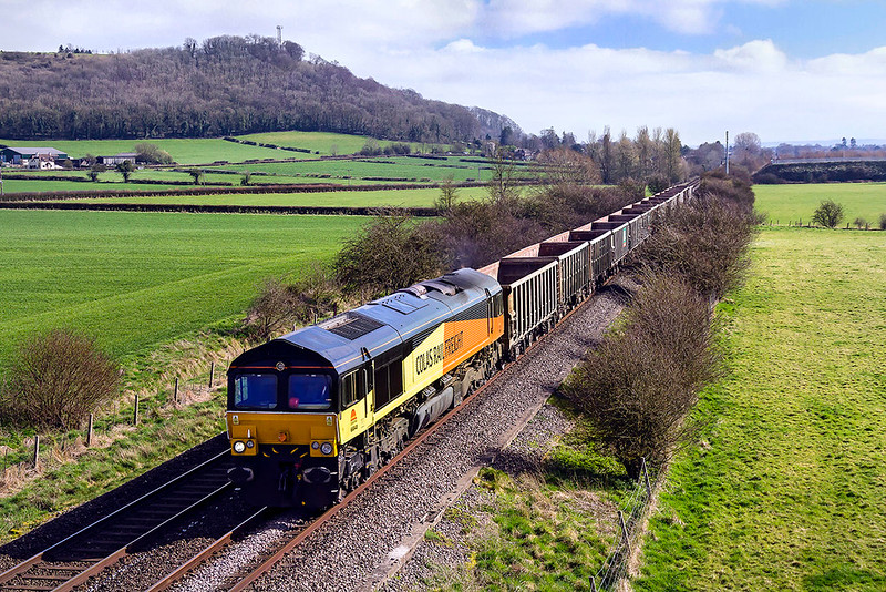 15th Mar 2017:  Pictured from Granada Bridge on the Warminster By-Pass is 66748 as it works 7V16 from Fareham to Whatley Quarry.  The is a DBCargo service so to find a Colas loco on the point is unusual