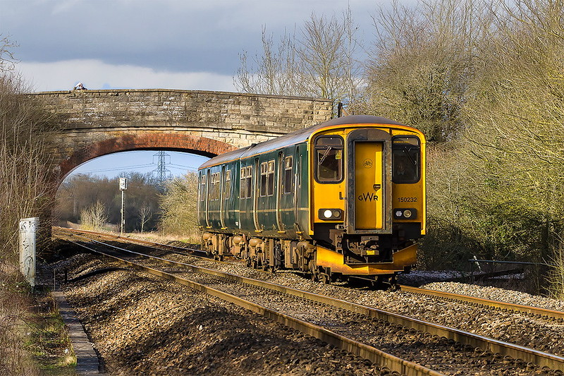10th Mar 2017: Church Road bridge in Heywood  forms the backdrop for 150232 as it passes with 2O90 the 12.51 from Great Malvern to Weymouth