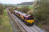 17th Mar 2017:  66238 with 66005 DIT are on the point of 6O41 the morning Westbury to Eastleigh departmental.  The location is Norton Bavant